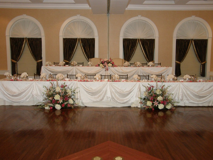 large bridal party so two tiered ceremony flowers sitting on the floor to add to