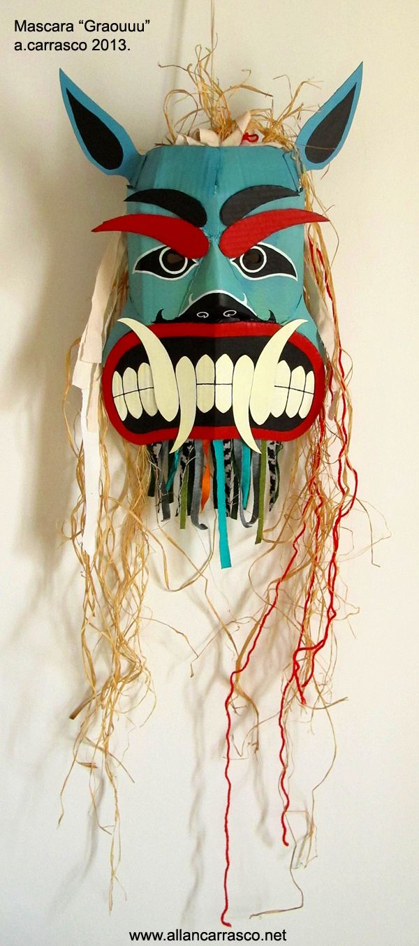 Cardboard mask painted with acrylics. Fabric fringes, raffia. 2013. Colors and patterns inspired by a Kwakwaka'wakw bear mask (Kwakiutl Indians). #kwakiutl #kwakwakawakw #mask #allandiegocarrasco