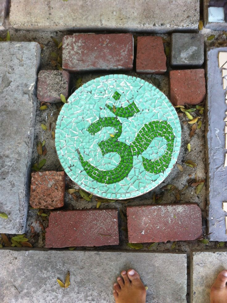 "the start of my mosaiced ""om"" garden - ""om"" stepping stone"