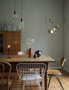 Swantje Hinrichsen Vintage Dining Table With Mismatched Chairs And  Lappalainen Brass Mobile.