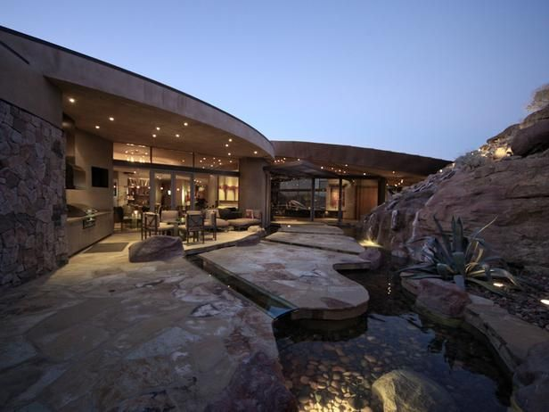 Desert Mansion in Palm Springs - This 15,000-square-foot mansion is worth more than $15 million and was custom engineered around the existing natural landscape. The front entrance and courtyard incorporate an amazing water feature integrated with the natural rock formations that were present on the property.