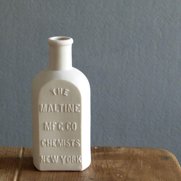 Use Pinterest appropriate mason jars, reclaimed timber, bricks and antique porcelain jars