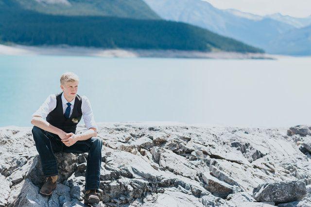 groom alone at Abraham Lake