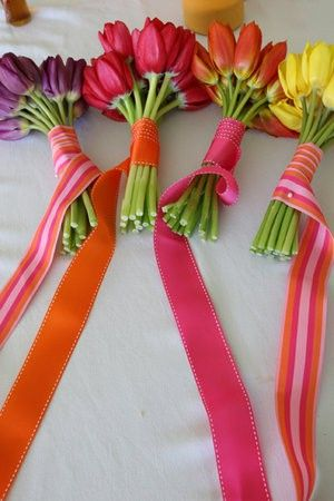 Multi color bouquets with the national flower of the Netherlands, Tulips! We also love the ribbons!