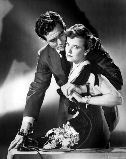 A publicity still of Robert Ryan and Laraine Day in The Woman on Pier 13 (1949).