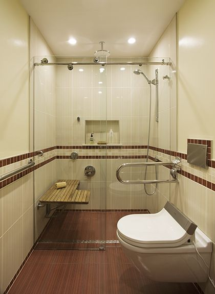 Universal Design, towel rack, hand rail in one, shower and toilet in one unit.