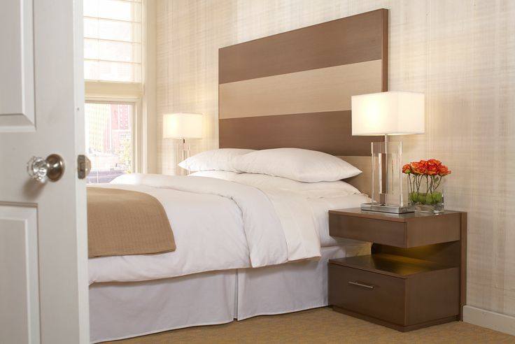 The Hudson Collection by Stacy Garcia for Hospitality Designs combines clean lines and sleek finishes for simplistic, chic design. Inspired by modern architecture, The Hudson Collection features a contemporary headboard wall with contrasting wood tone elements. Hudson furniture can be customized to any size, shape, or finish. Ask about our custom hotel furniture services today. #hotelfurniture