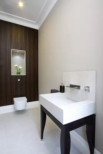 Macassar wood cloakroom by Macassar Properties - London investment and development company