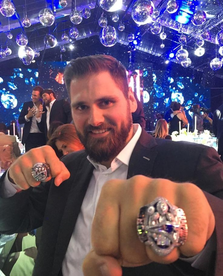 Sebastian Vollmer with his second SB ring!! Plus Tom and David in the back.