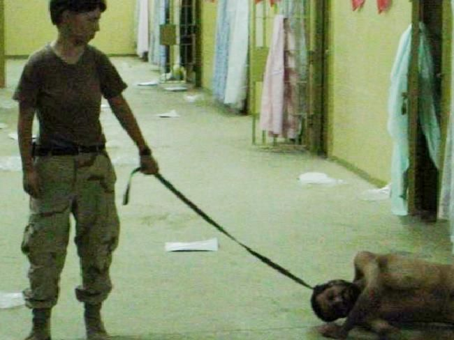 Abu Ghraib: Obtained by The Associated Press, this image shows Private Lynndie England holding a leash attached to a detainee at the Abu Ghraib prison in Baghdad, Iraq, 2003.