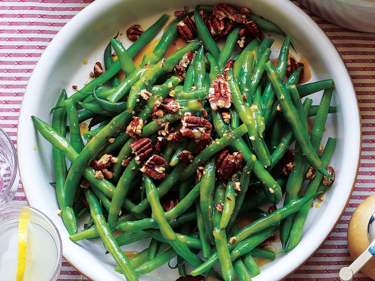 Green Beans with Pecans and Maple Vinaigrette | See our collection of our best green bean recipes for a variety of easy ways to prepare this popular vegetable including sautéing, steaming, and roasting. These simple green bean sides are anything but boring and bland. Whether you prefer nutty additions, a creamy sauce, or a hit of seasonal stir-ins, we've got the green bean recipe that's perfect for your table. Don't relegate green beans to the holidays; these dishes are perfect for your…