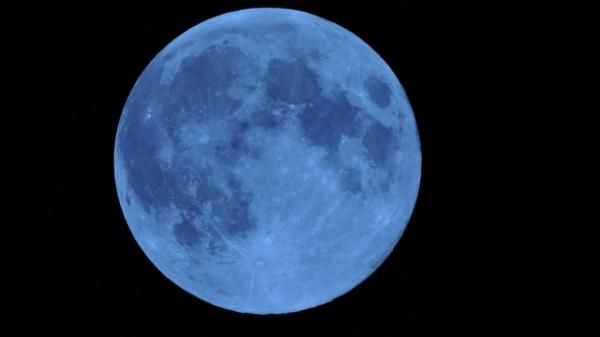 """There's a reason why """"once in a blue moon"""" is a saying and tonight will prove it. A blue moon is defined as any time there is a second full moon during a calendar month, according to NASA. A truly blue colored moon can occur on rare occasions, according to NASA, with most being spotted after volcanic eruptions."""