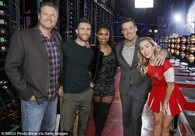 With his crew: Adam, second left, with fellow judges Black Shelton and Jennifer Hudson, host Carson Daly and judge Miley Cyrus