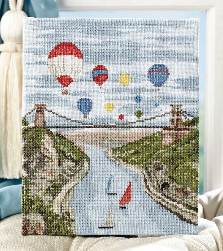 Give this scenic view a twist with a riot of red and blue in Jenny Barton's boat and balloon filled fun-scape! Avaible in Cross Stitch Collection 233