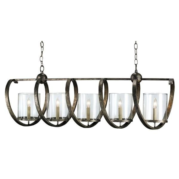 Whimsical spirals encircle the seeded glass shades of this bold five light fixture, an ideal choice for elongated spaces. The Maximus Rectangular Chandelier's masterfully crafted linear wrought iron frame, finished in a rich Pyrite Bronze, instills in this piece a cool industrial feel. PRODUCT NAME: Maximus Rectangular Chandelier DIMENSIONS: 16h x 13d x 47w NUMBER OF LIGHTS: 5 MATERIAL: Wrought Iron/Glass FINISH: Pyrite Bronze WATTAGE PER LIGHT: 60 TOTAL WATTAGE: 300 BULB TY...