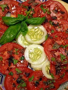 Tomatoes, cucumbers and Basil. Simple and healthy...and it tastes good too!