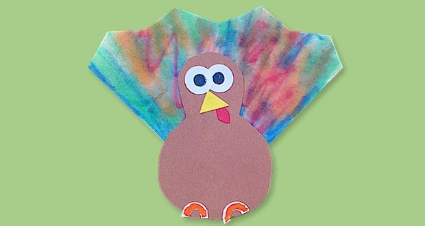 An easy preschool Thanksgiving craft for kids. Use 1/4 of a coffee filter to make these cute little Thanksgiving Turkeys. Free Printable from ActivitiesForKids.com.