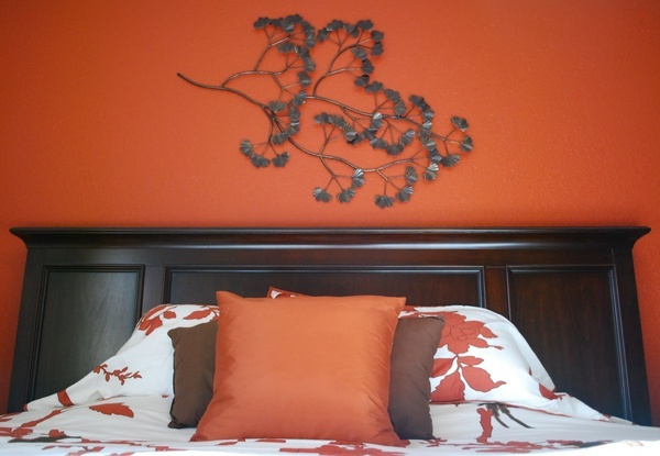 Burnt-orange bedroom wall with brown and white accents.