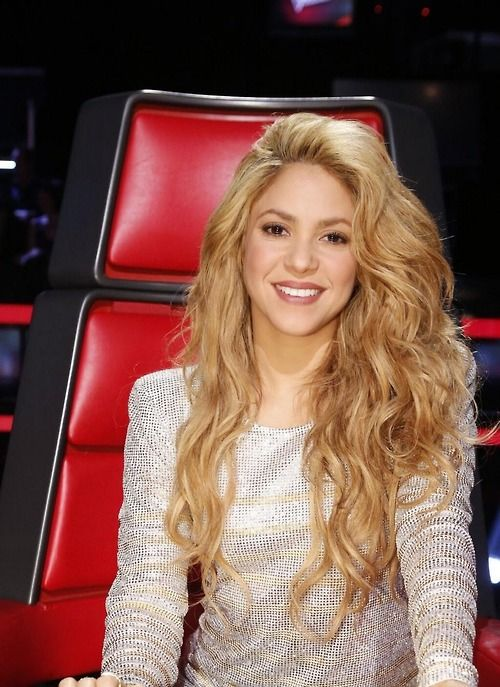 Shakira without her tight curls. Long, blonde, layers, thick. Lovely.