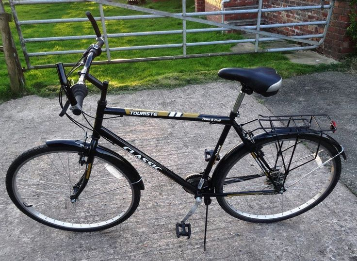 """Classic Men's Touriste Commuter Bike - Black  Classic Touriste Town & Trail Bike for sale in good working order, it has every day marks on as you would expect. Shimano 18 speed gears Shimano RevoShift SIS index gear shifters Wheels 28"""" – 1 5/8 – 1 ½   (40 – 622) Frame pedals to seat post 20"""" – seat post to handlebars 23"""" The bike has Mudguard's, back bike rack & kick stand.  For sale £55.00 For more information call me *SOLD*"""