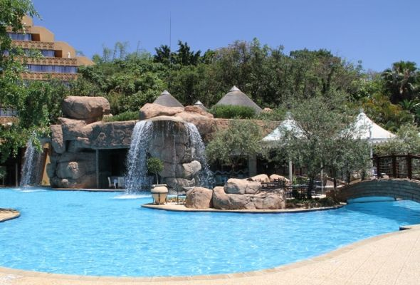 Beautiful pool with a waterfall at the Cascades Hotel Sun City in South Africa