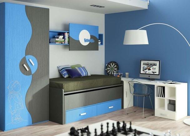 Habitación infantil con un compacto de 2 camas más 2 cajones con armario de puertas esfera de diseño muy original. El dibujo láser y la estantería con el nombre personalizado.