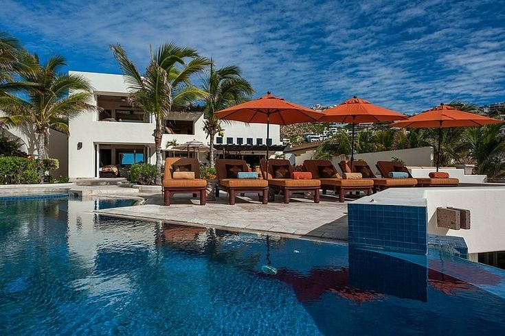 poolside umbrella & chairs -- Pedregal Beach Front by Wendy Zolezzi Design