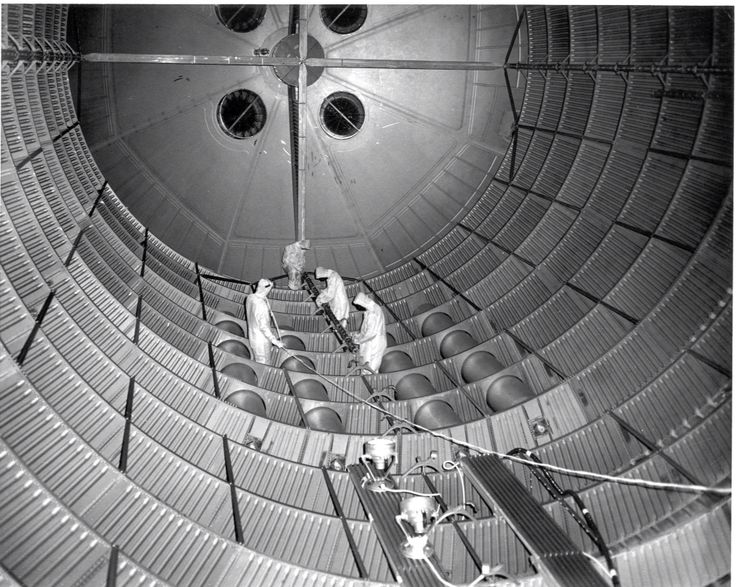 Boeing Technicians Work On The Inside Of The Giant Saturn