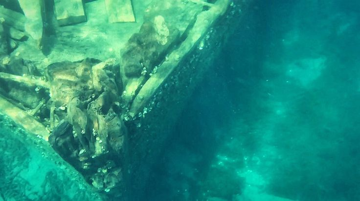 An underwater photo of a shipwreck in Tobermory, ON.