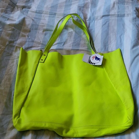 American apparel leather tote bag NWT neon yellow American apparel Beautiful neon yellow leather tote bag.. tags attached!  Never used.. No defects in mint condition. .No trades American apparel  Bags Totes