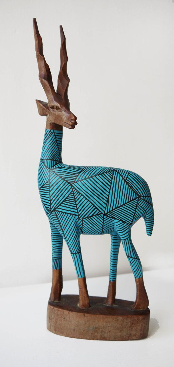 Original 1970s wooden carving from Africa. This has been sanded and painted an eye popping teal and an illustrative linear motif has been added by hand to finish it off.