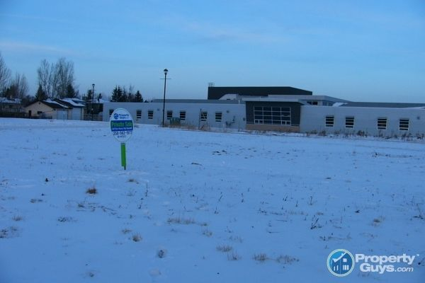 Private Sale: 702 Ranch Crescent, Carstairs, Alberta - PropertyGuys.com
