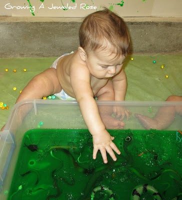Embed small items in a large pan of jello and let little ones squish through to get them.