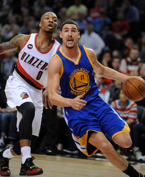 Description of . Golden State Warriors' Klay Thompson (11) drives against Portland Trail Blazers' Damian Lillard (0) during the first half of an NBA basketball game in Portland, Ore., Tuesday, March 24, 2015. (AP Photo/Greg Wahl-Stephens)