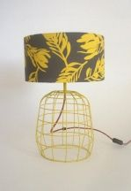 Table Lamp with yellow conebush shade and wire base.