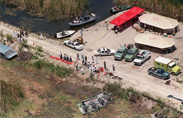 ValuJet Crash Of 1996 ~ Rescue workers operate out of a command post 13 May set up on a levee some 300 yards west of the crash site of Valujet flight 592.