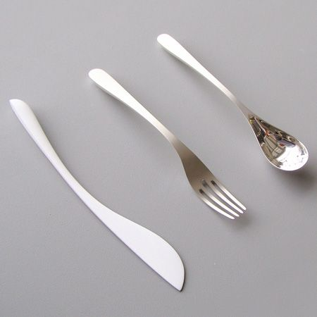 Shape/Form Cutlery set by Lukas Peet - Canadian Designer. The forks and spoons are silver and the knives are ceramic