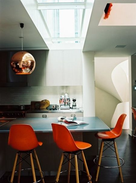 Copper and orange stools. Absolutely love the modern kitchen with the bright colored stools! It completes the whole look.