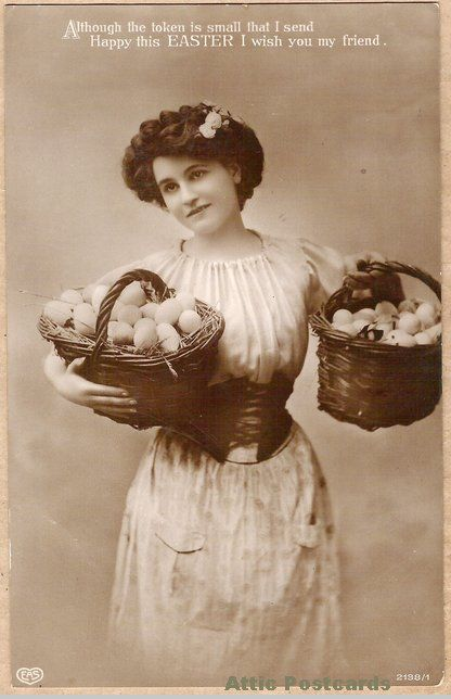 Vintage real photo Easter greetiings postcard showing a young woman with baskets of eggs. Printed in Berlin.
