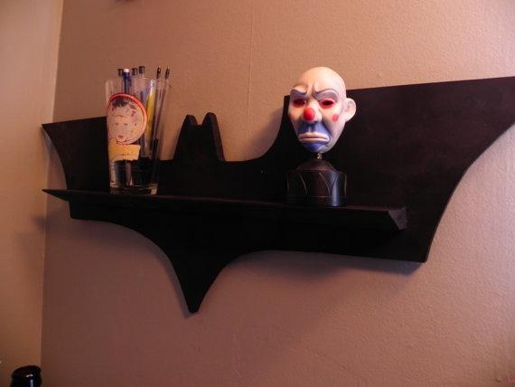 Batman Knicknack shelf!   http://www.etsy.com/listing/93997237/the-batshelf?ref=sc_1=sr_e1e61eba3e4c9f5df55a117a407bcac9c1fda5aec56dbfd0adb43c7fda5d5925_1330960298_14194946_geek