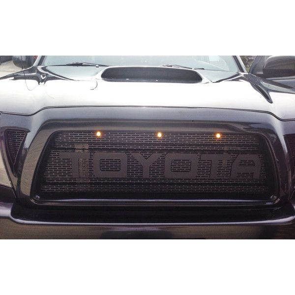 2005-2011 Toyota Tacoma 3 Piece Raptor Style mesh insert for grill (Includes all models) Includes: 2 Triangle mesh pieces 1 center mesh 6 letters as seen in pic