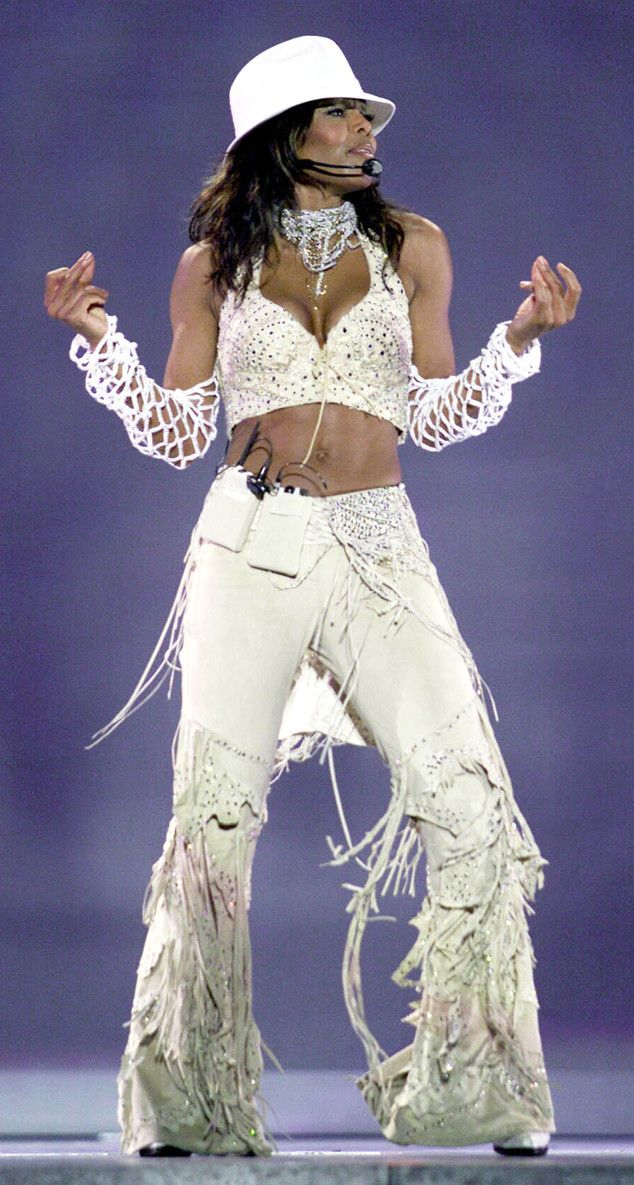 """Fringe Benefits from Janet Jackson's Best Looks From Red Carpet to Concerts  The star's 2001 """"All For You"""" tour called for fringe, netted sleeves and a bright white fedora (naturally)."""
