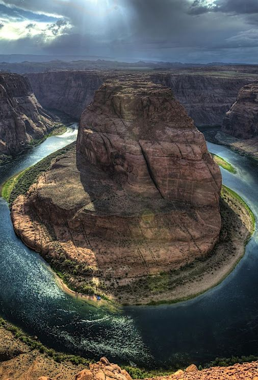 Horseshoe Bend, Colorado River absolutely GORGEOUS  This bend in the Colorado River is getting plenty of attention from those looking for the Grand Canyon. It is located approximately 140 miles from both the South Rim and the North Rim of the Grand Canyon – but only 5 miles from the beginning of Grand Canyon National Park. You can experience Horseshoe Bend when traveling from Rim to Rim via Highway 89/89A by simply taking a short 18 mile excursion towards Page, Arizona.