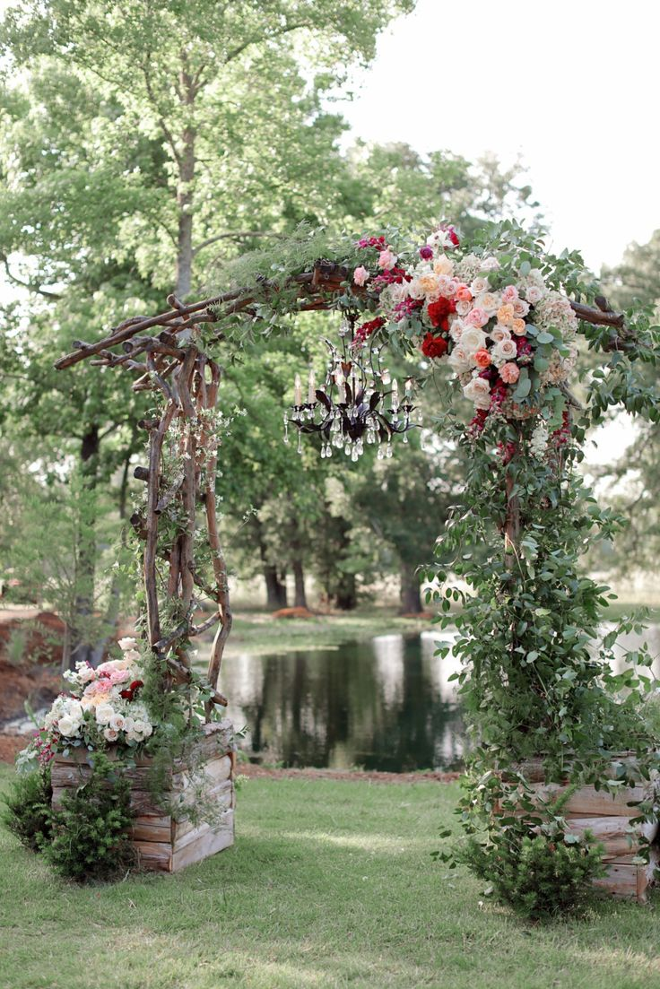 Giant floral arbor with chandelier