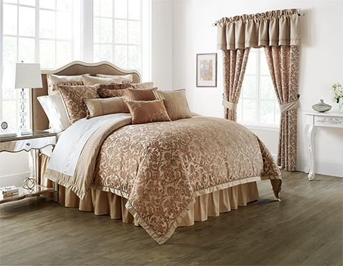 Margot Persimmon by Waterford Luxury Bedding adds warmth to a traditional scroll. The comforter and matching pillow shams present a scroll with a romantic impression as the focus of the collection. The reverse of the comforter is a complimentary fabric. The Margot Persimmon comforter set is available in Queen through California King sizes and include the comforter, two pillow shams, and coordinated bedskirt. The collections bedskirt is ruffled for a classic style. Coordinating euro shams…