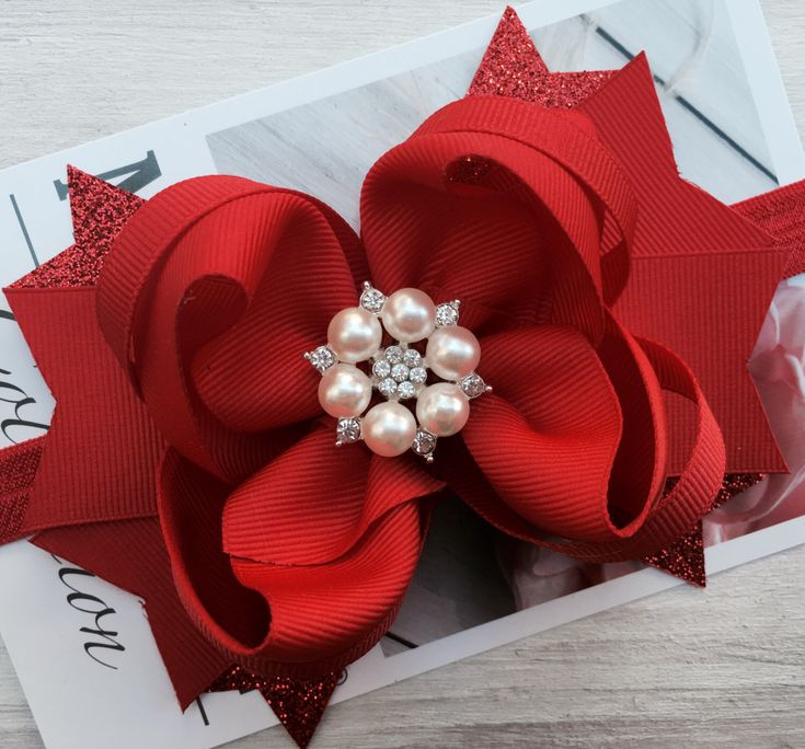 Holiday hair bow, red dressy occasion bow, Christmas hair bow, hair accessories, over the top bows, black hair how, big bow, boutique bow by ModernMeCollection on Etsy https://www.etsy.com/listing/486253981/holiday-hair-bow-red-dressy-occasion-bow