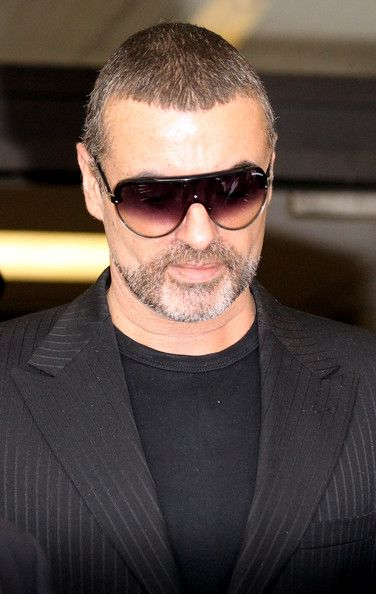 George Michael Photos Photos - Singer George Michael leaves Highbury Corner Magistrates Court on August 24, 2010 in London, England. Mr Michael pleaded guilty to driving under the influence of drugs and possessing cannabis after he crashed his car into a photo processing shop in London on July 4, 2010. - George Michael Appears In Court Charged With Driving Offences