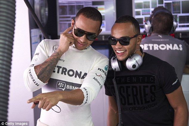 Boy racers Lewis and Nicolas Hamilton (right) in the Mercedes garage