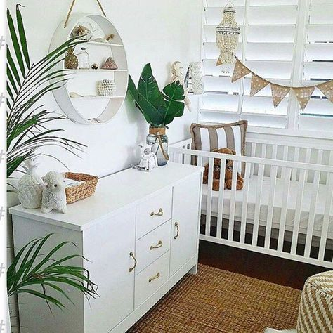 Tropical nursery decor // island inspired design // baby room decorations // green // decorating with plants
