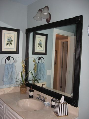 Southernhospitality diy framing boring mirrors great for guest bathroom bathroon update for Pinterest framed bathroom mirrors